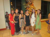 During christmas party, beautiful girls with their best outfits.