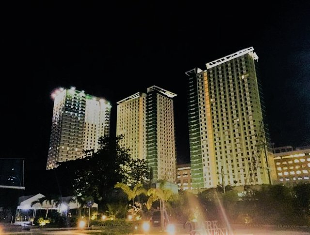 the view of I.T Park Cebu, at night, tall buildings