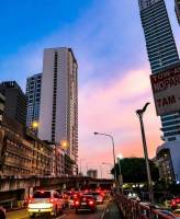 Pinkish sunset complemented by the heavy traffic build up and urbanscape, city life