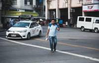 Street photography, young man crossing the street